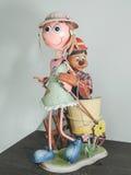 De pop van het ijzermeisje met emmer Stock Fotografie
