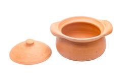 De pot en het deksel worden geplaatst op de vloer stock afbeelding