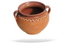 De pot van de klei met schaduw die over wit wordt geïsoleerde Royalty-vrije Stock Foto