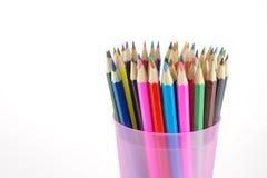 De potloden van de kleur in de roze steun Stock Afbeelding