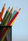 De potloden van de kleur op blauw Stock Foto