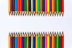 De potloden van de kleur op witte achtergrond sluiten omhoog Stock Foto