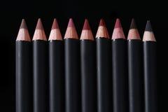 De Potloden van de lippenvoering op Zwarte Achtergrond Stock Afbeelding