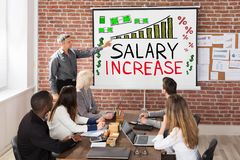 De Presentatie van de salarisverhoging stock afbeeldingen