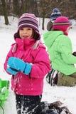 De pret van kinderen op de sneeuw royalty-vrije stock afbeelding