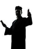 De priestersilhouet van de mens Royalty-vrije Stock Afbeeldingen