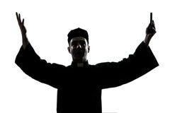 De priestersilhouet van de mens zegen Royalty-vrije Stock Afbeeldingen