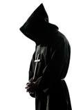 De priestersilhouet van de mensenmonnik het bidden Royalty-vrije Stock Afbeeldingen