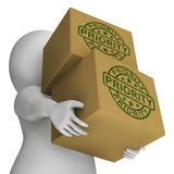 De prioritaire Zegel op Dozen toont Spoed en Dringende Pakketten Royalty-vrije Stock Foto's