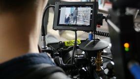 De Professionele Cameraman Films Scene van de achtereindmening stock footage