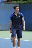De professionele tennisspeler Sergiy Stakhovsky tijdens zijn eerste ronde dubbelen past bij US Open 2013 aan Royalty-vrije Stock Afbeeldingen