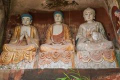 De Provincie van de Anyueprovincie, Sichuan in de Noordelijke tempel van het de Pauwhol van de Lieddynastie leidde drie Boedha to Stock Afbeeldingen