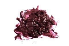 De purpere Steekproef van de room glanzende Lippenstift royalty-vrije stock fotografie