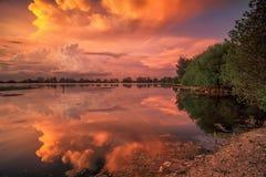 De röda molnen Royaltyfri Foto