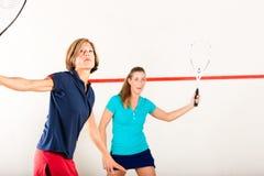 De racketsport van de pompoen in gymnastiek, de vrouwenconcurrentie Royalty-vrije Stock Fotografie
