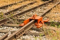 De Rail. De-Rail Device on Track during construction in a rail yard. Uttaradit railway station, Thailand. Photo taken on: March 07th, 2015 stock photo