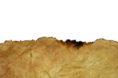 De rand van het uitgebrande blad van oud vergeeld verfomfaaid perkament stock afbeeldingen