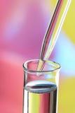De reageerbuis en het druppelbuisje van het glas Royalty-vrije Stock Afbeeldingen
