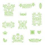 De reeks emblemen, zegels, kentekens, etiketteert voor natuurlijke producten, organische landbouwbedrijven, Bloemenelementen en w Royalty-vrije Stock Afbeelding