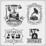 De reeks uitstekende antiquiteiten winkelt etiketten, kentekens, emblemen en ontwerpelementen royalty-vrije illustratie