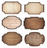 De reeks van bruin houten uithangbord, de planken en de donkere kaders zijn geïsoleerd op witte achtergrond Stock Foto