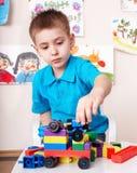 De reeks van de het spelbouw van het kind thuis. Stock Afbeelding