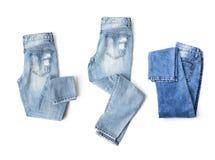 De reeks van drie jeans op witte achtergrond Stock Afbeeldingen