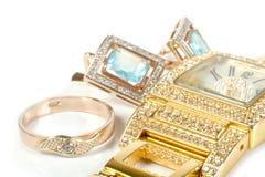 De reeks van juwelen, ring, horloge, oorringen Stock Foto