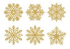 De reeks van schittert gouden Sneeuwvlokken De winterelementen Glanzende sneeuwvlokken op witte achtergrond Stock Fotografie