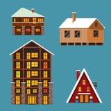 De reeks van de verschillende winter wodden und baksteenhuizen en hotels Stock Foto's