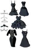De reeks van weinig zwarte kleedt zich en laagrekken Stock Fotografie
