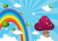 De regenboog en de reuzepaddestoel Royalty-vrije Stock Afbeeldingen
