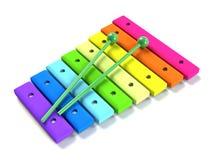 De regenboog houten xylofoon van jonge geitjes Stock Foto