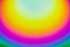 De regenboog omcirkelt Achtergrond Stock Foto's