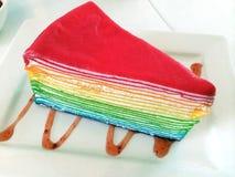 De regenboog omfloerst cake Stock Foto's