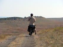De reis van de fiets door de bergen Royalty-vrije Stock Afbeeldingen