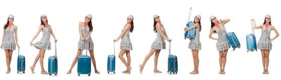 De reizende die vrouw met koffer op wit wordt geïsoleerd Stock Afbeelding