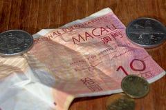 De rekening en de muntstukken van Macao Pataco royalty-vrije stock foto