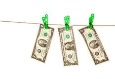 De rekeningen van de dollar die aan een drooglijn worden gespeld Royalty-vrije Stock Foto