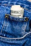 De rekeningen van de dollar in jeans Stock Foto