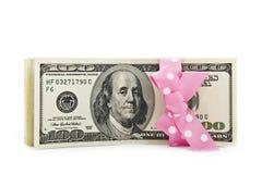 De rekeningen van de dollar met een boog Stock Fotografie