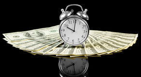 De rekeningen van het dollargeld met klok Royalty-vrije Stock Afbeelding