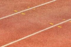 De Renbaan van de atletiek Stock Foto's