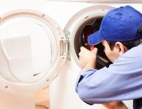 De reparatie van de wasmachine Royalty-vrije Stock Afbeelding