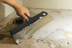 De reparatie van pleistermuren royalty-vrije stock afbeeldingen