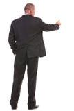 De retour d'un homme d'affaires poussant un bouton photos libres de droits