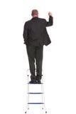 De retour de l'écriture d'homme d'affaires sur une échelle photo stock