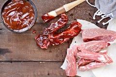 De Ribben van het land en Barbecuesaus stock afbeeldingen