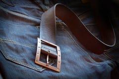 De riem van het leer meer dan een paar jeans stock foto