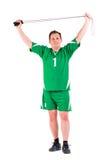 De rijpe mens kleedde zich in het groene sportkleding stellen Stock Fotografie